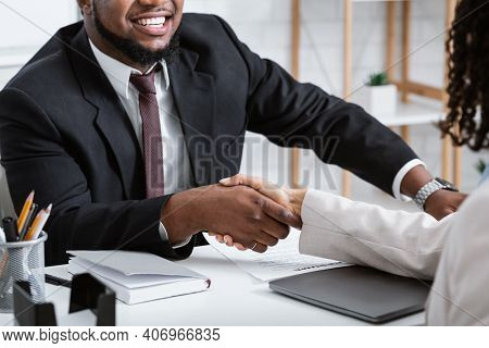 Unrecognizable African American Hiring Manager Shaking Hand Of Vacancy Candidate During Employment I
