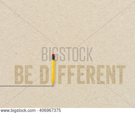Yellow Pencil With Message Be Different On Brown Recycled Paper Background