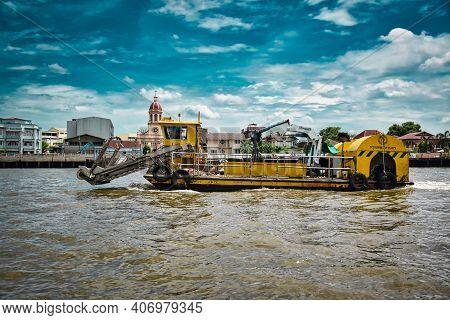 Bangkok, Thailand 08.20.2019 A Huge, Giant Yellow Construction Boat On The Chao Phraya River