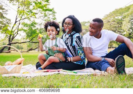 Happy African American Family Life Concept. African American Parents (father, Mother) And Little Boy