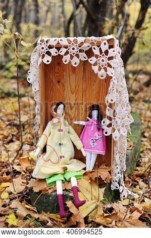 Handmade Tilda Fabric Dolls In Wooden Box In The Autumn Forest. Vintage Style Decor For Photoshootin