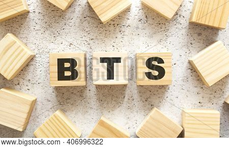 The Word Bts Consists Of Wooden Cubes With Letters, Top View On A Light Background. Work Space.
