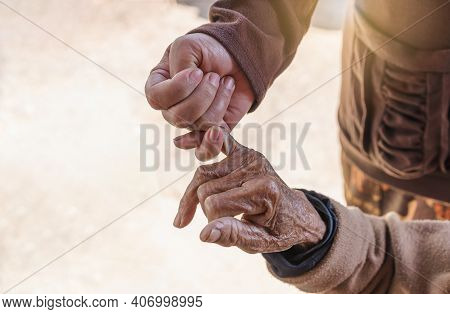 Close Up Of Young Woman Holding Hand Of Her Mother, Family Time, Hook Each Other's Little Finger. Se