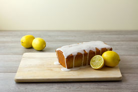 A Glazed And Unsliced Lemon Loaf Cake