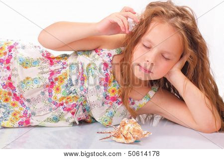 Calm Little Girl With Seashell And Starfish