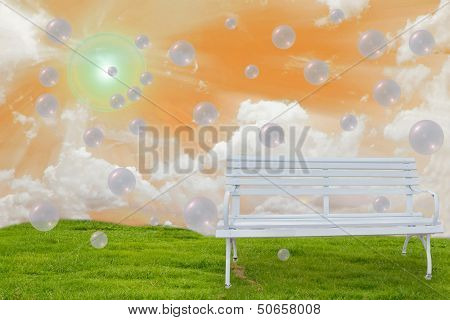 White Bench On Grass Field with Orange Sky Background. poster