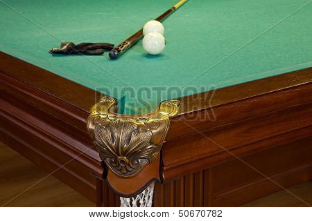 Billiard Table, Hole, Balls, Cue And Glove On Green Cloth