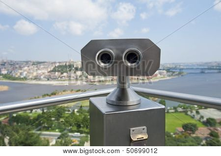 Pair of binoculars on an aerial viewing platform overlooking istanbul from famous Pierre Loti Cafe poster