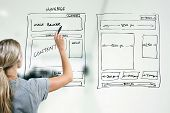 designer drawing website development wireframe with marker poster