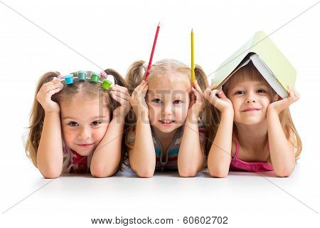 kids with book, pencils and paints on their heads