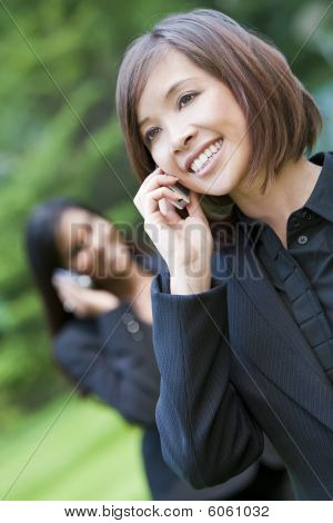 Beautiful Chinese Asian Oriental Woman Talking On Her Cell Phone