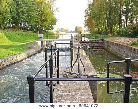 Channels Of Sluice In Water Barrier