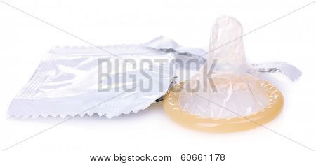 Open pack and condom isolated on white