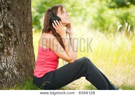 Young Woman With Headphones Outdoor