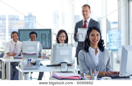 Male Manager Supervising His Team In A Call Center