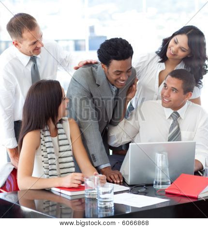 Successful Business Team Working Together In Office