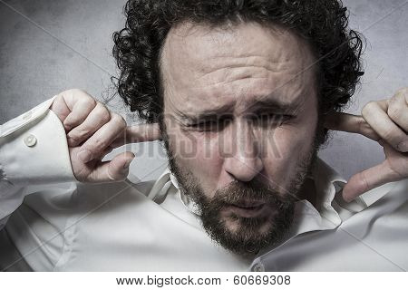 Businessman covering his ears, man in white shirt with funny expressions