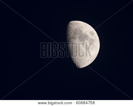 Bright half moon in the silent sky