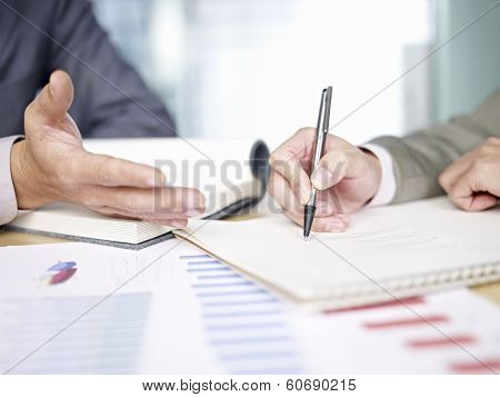 Business People Reviewing Sales Performance