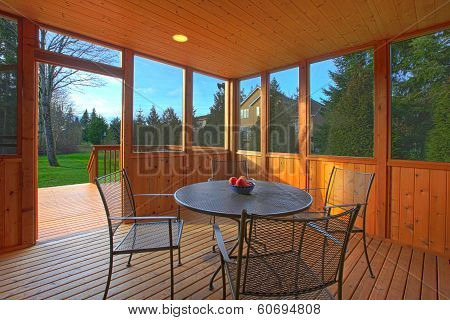 Screened Porch With A Dining Table Set