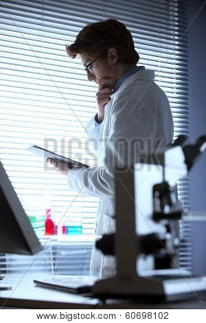 Researcher Reading Medical Records