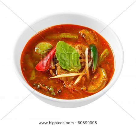 Close up spicy red curry with pork fingerroot basil egg plant pepper and chili without coconut milk - with path poster