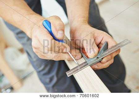 Close-up carpenter process of wood door marking for locksmith installation poster