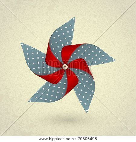Vintage handmade red and blue pinwheel with dots