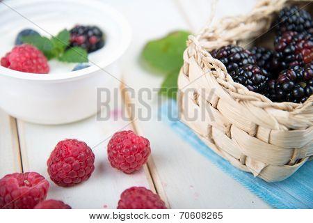 Fresh Berrys Fruit In Basket On Wooden Table