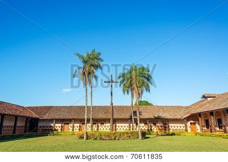 Courtyard and cross in the UNESCO World Heritage Jesuit Mission in Concepcion Bolivia poster