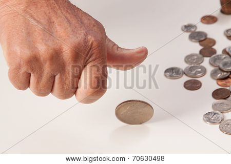 Man's hand tossing coin closeup