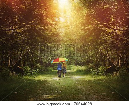 Children Walking In Sunshine Woods With Umbrella