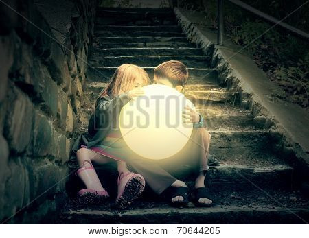 Children Holding Bright Sun On Stairs