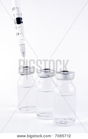 Syringe and vials