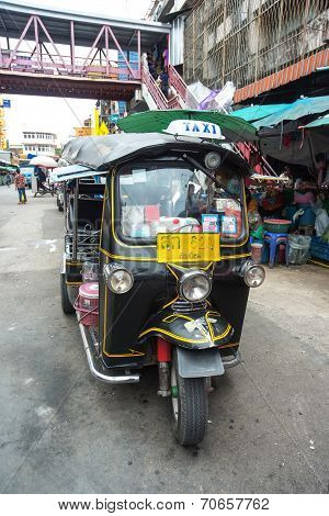 Famous Three-wheeled Taxi (tuktuk) Parking At The Street