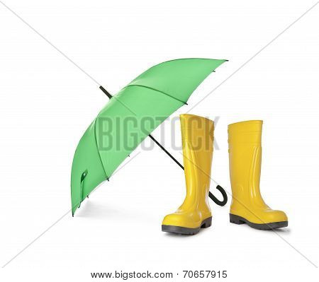 A pair of yellow rain boots and a green umbrella