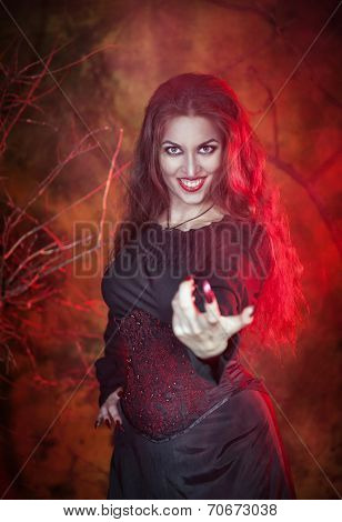 Beautiful Woman In Halloween Style Beckoning Finger