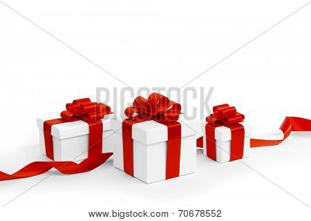 White gift boxes with red ribbons isolated on white background