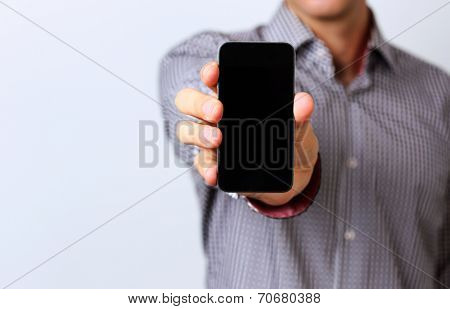 Closeup portrait of a male hands holding smartphone