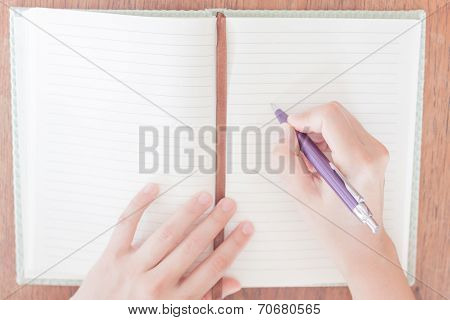 Woman Writing On Her Notebook