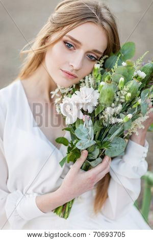 Portrait of beautiful woman with herbal bouquet