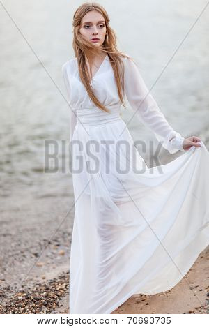 Portrait of beautiful woman on the beach