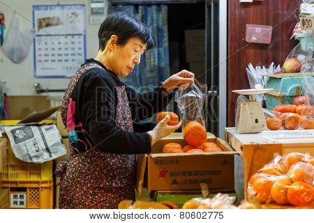 Japanese Shopkeeper at Nishiki Market in Kyoto