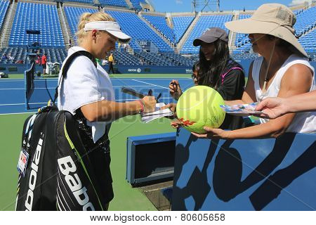 Professional tennis player Caroline Wozniacki signing autographs after practice for US Open 2014