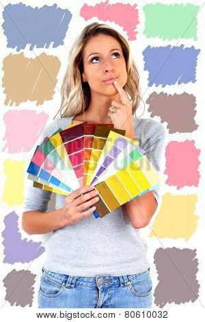Woman choosing a color for painting. House renovation