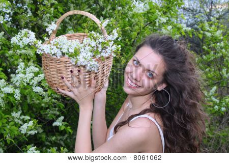 Smiling young woman in her garden