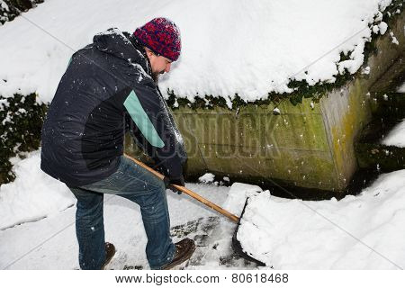 Man Is Snow Shoveling The Snowy Path