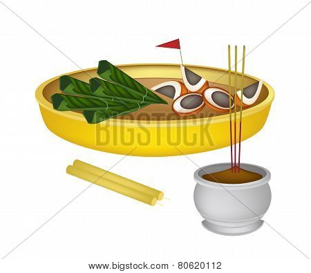Areca Nuts and Betel Leaves with Candle and Joss Stick