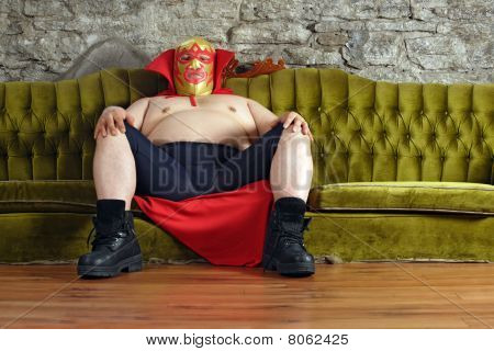 Mexican Wrestler Sitting On A Couch