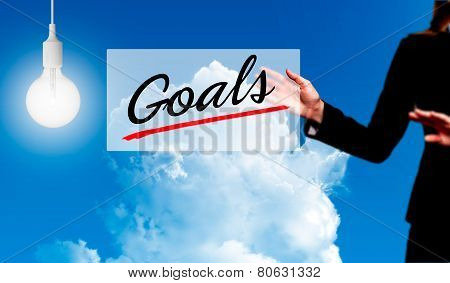 Business woman holding Goals sign - business concept